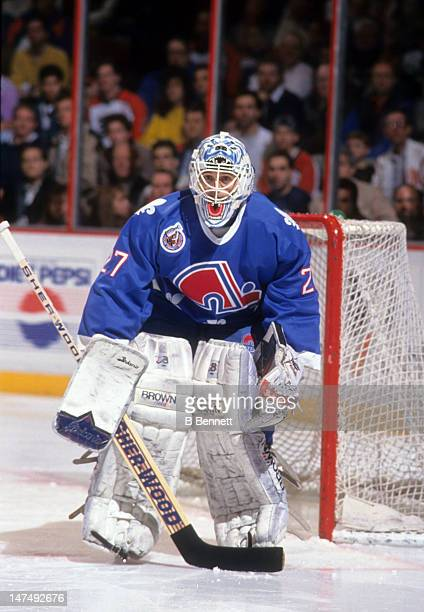Goalie Ron Hextall of the Quebec Nordiques defends the net during an NHL game against the Philadelphia Flyers circa 1993 at the Spectrum in...