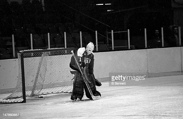Goalie Ron Low of the Washington Capitals makes the save during warmups before the game against the New York Rangers on October 9 1974 at the Madison...