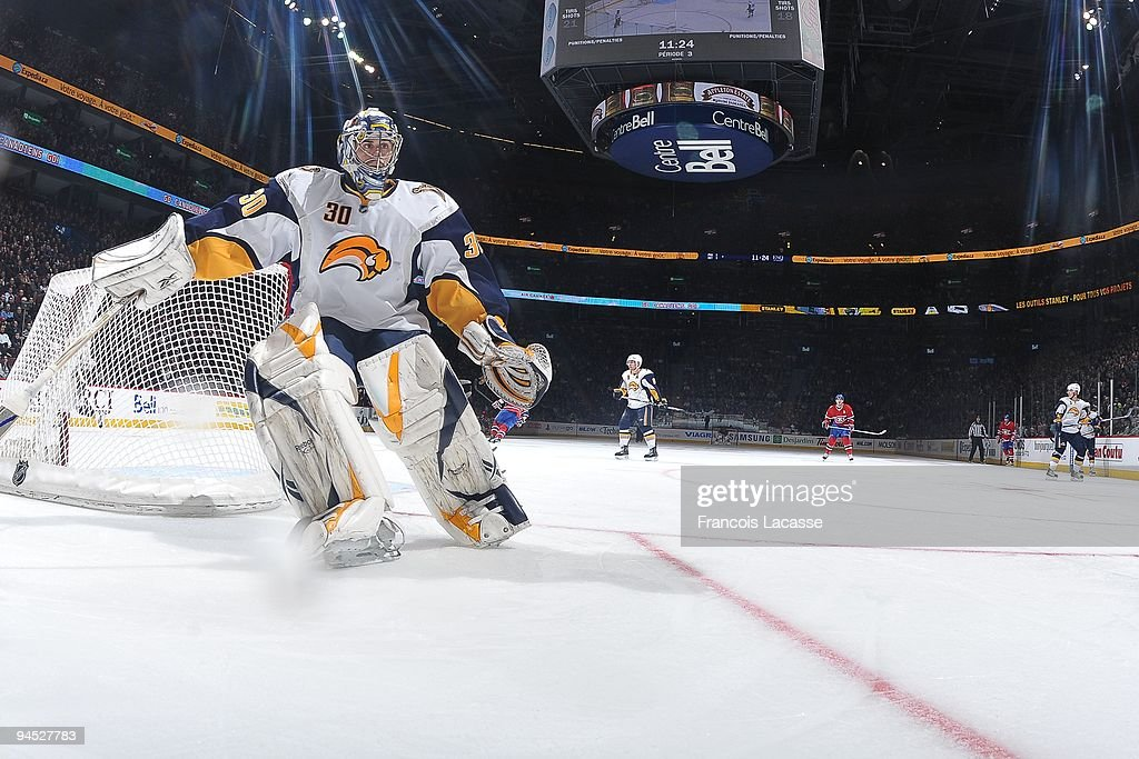 Goalie <a gi-track='captionPersonalityLinkClicked' href=/galleries/search?phrase=Ryan+Miller+-+Ice+Hockey+Player&family=editorial&specificpeople=206960 ng-click='$event.stopPropagation()'>Ryan Miller</a> #30 of Buffalo Sabres reaches for the puck behind his net during the NHL game against the Montreal Canadiens on December 14, 2009 at the Bell Centre in Montreal, Quebec, Canada.
