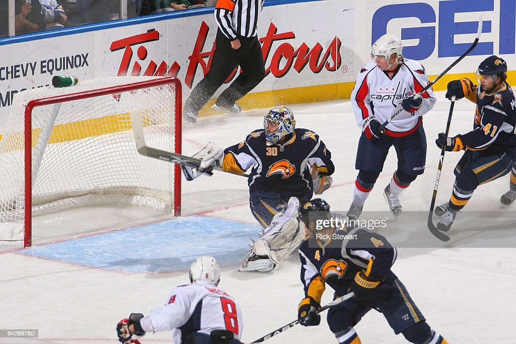 Goalie Ryan Miller of the Buffalo Sabres deflects the puck during the game against the Washington Capitals on December 9 2009 at HSBC Arena in...