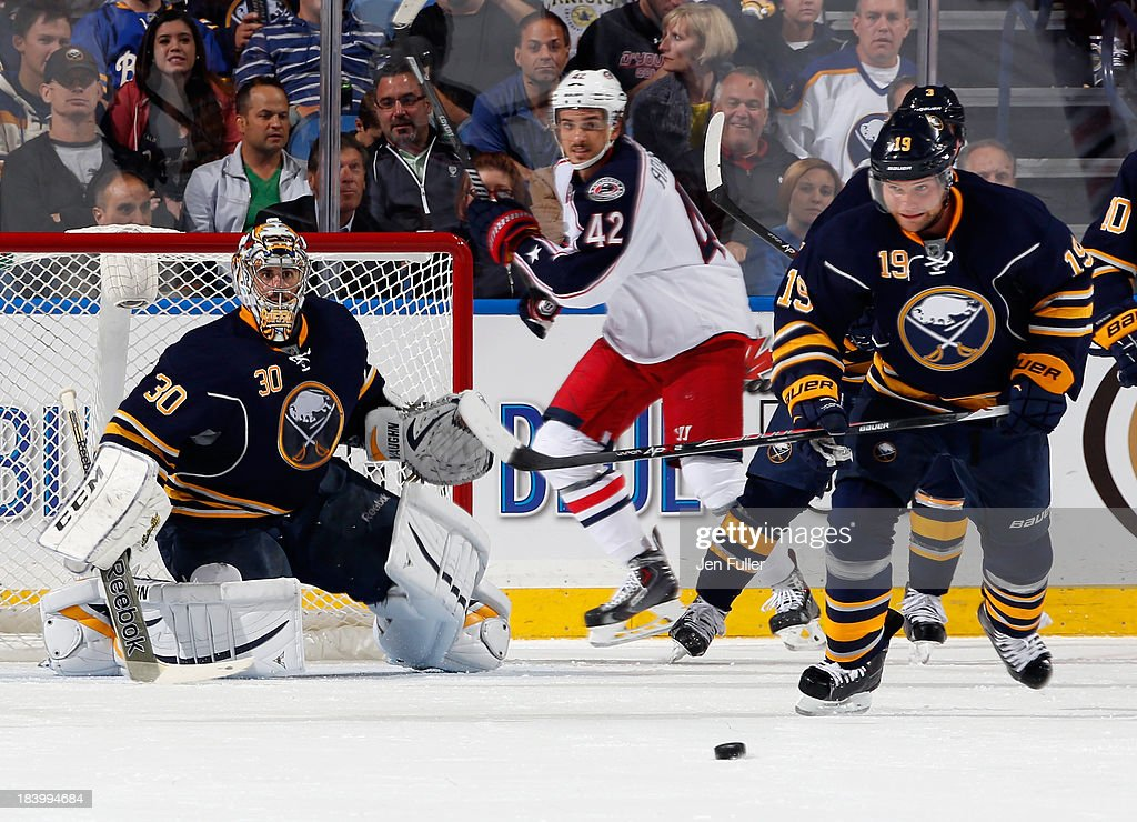 Goalie Ryan Miller #30 of the Buffalo Sabres follows the play as teammate <a gi-track='captionPersonalityLinkClicked' href=/galleries/search?phrase=Cody+Hodgson&family=editorial&specificpeople=4151192 ng-click='$event.stopPropagation()'>Cody Hodgson</a> chases after the puck in a game against the Columbus Blue Jackets at First Niagara Center on October 10, 2013 in Buffalo, New York. Columbus defeated Buffalo 4-1.