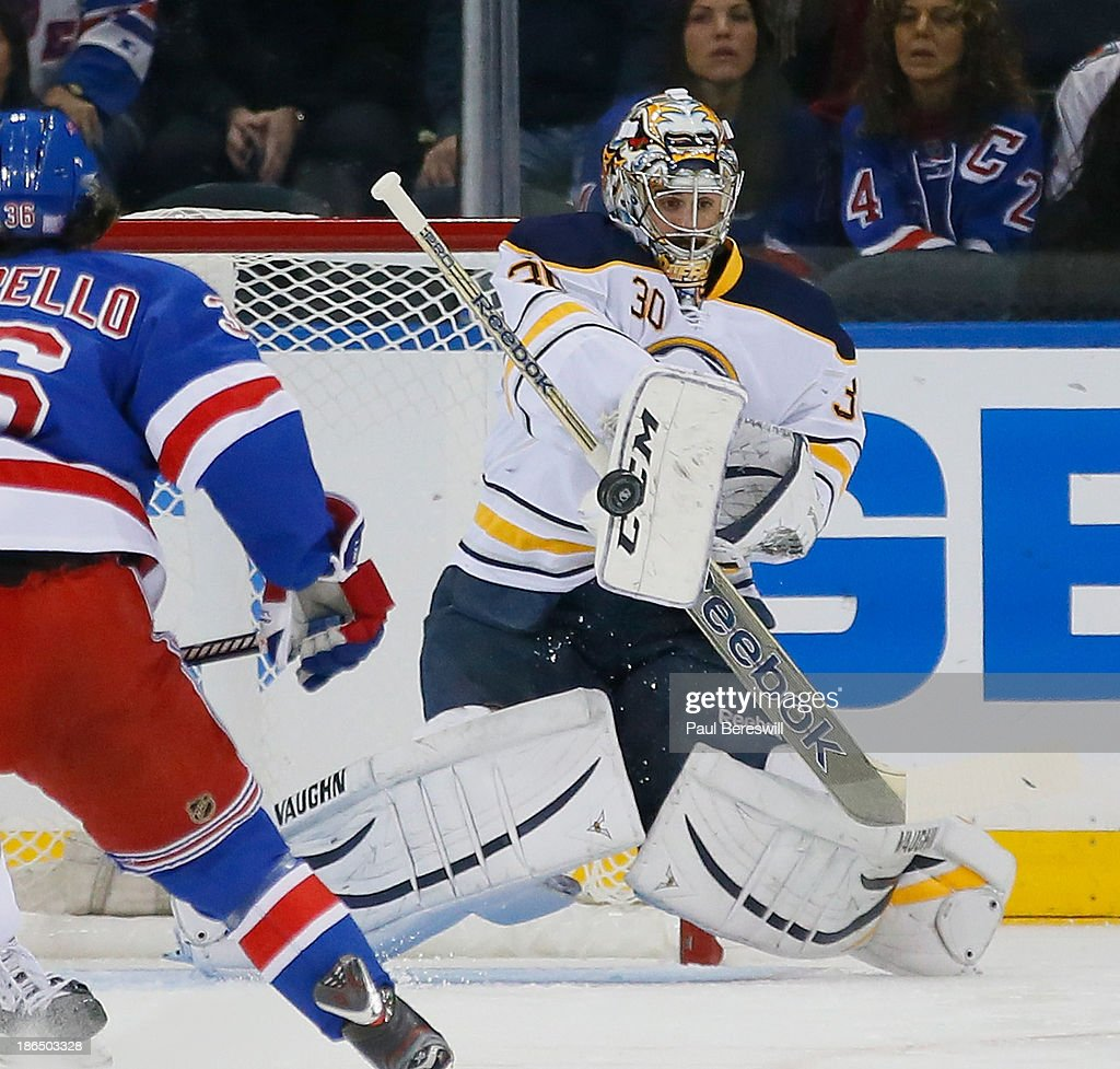 Goalie Ryan Miller #30 of the Buffalo Sabres makes a save during the first period of an NHL hockey game against the New York Rangers at Madison Square Garden on October 31, 2013 in New York City.