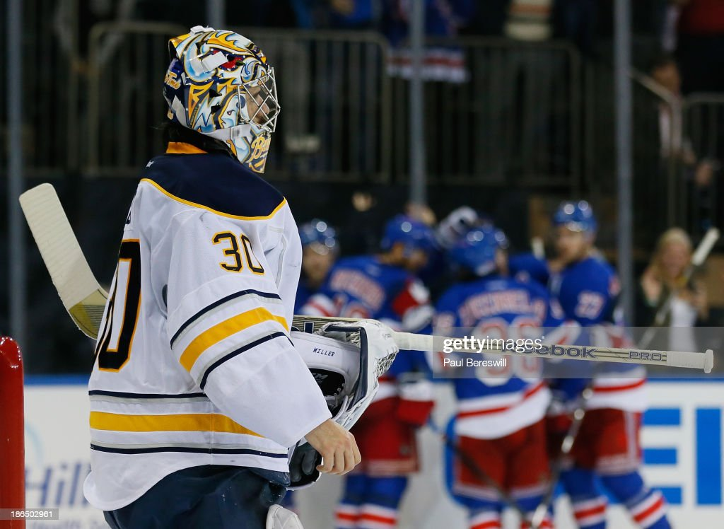 Goalie Ryan Miller #30 of the Buffalo Sabres stares as the New York Rangers celebrate a goal by <a gi-track='captionPersonalityLinkClicked' href=/galleries/search?phrase=Chris+Kreider&family=editorial&specificpeople=5894671 ng-click='$event.stopPropagation()'>Chris Kreider</a> in the background during the second period of an NHL game at Madison Square Garden on October 31, 2013 in New York City.