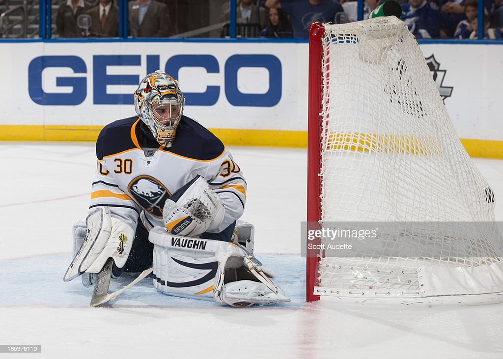 Goalie Ryan Miller #30 of the Buffalo Sabres watches the puck go into the net for a goal for the Tampa Bay Lightning during the third period at the Tampa Bay Times Forum on October 26, 2013 in Tampa, Florida.