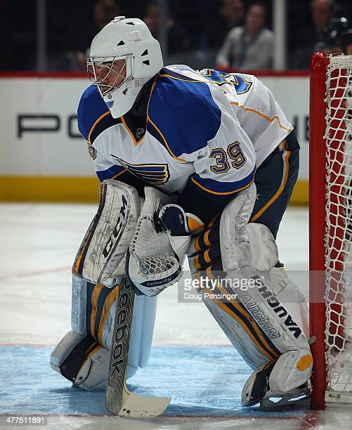 Goalie Ryan Miller of the St Louis Blues looks on as he defends the goal against the Colorado Avalanche at Pepsi Center on March 8 2014 in Denver...