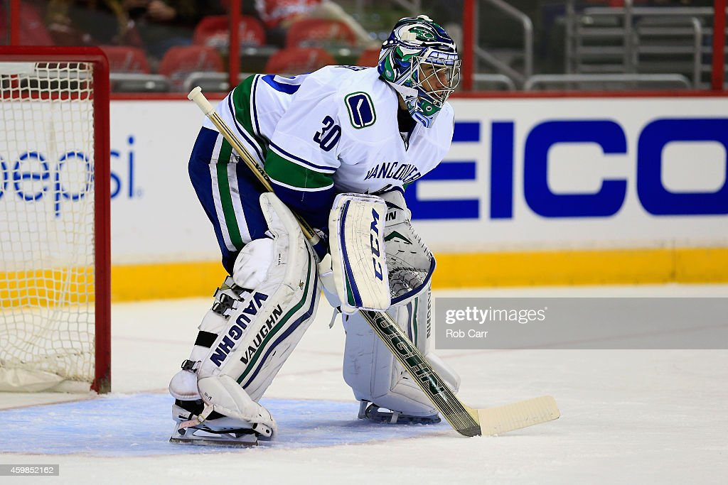 Goalie Ryan Miller of the Vancouver Canucks follows the puck during the first period against the Washington Capitals at Verizon Center on December 2...
