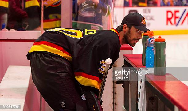 Goalie Ryan Miller of the Vancouver Canucks looks out onto the ice prior to the start of a game against the Toronto Maple Leafs in NHL action on...