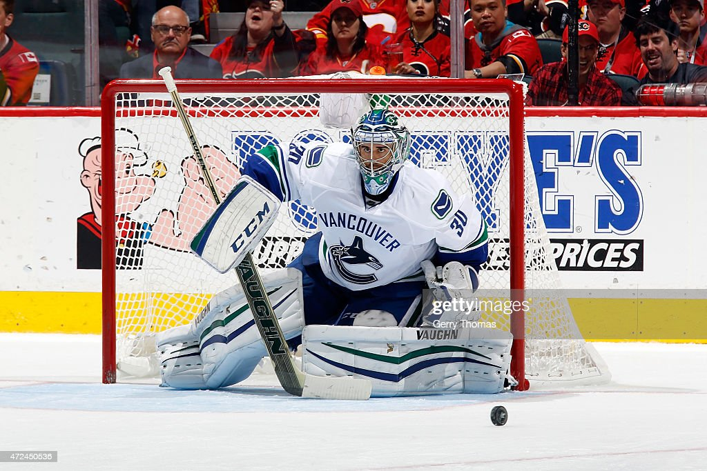 Goalie Ryan Miller of the Vancouver Canucks makes a save against the Calgary Flames at Scotiabank Saddledome for Game Six of the Western...