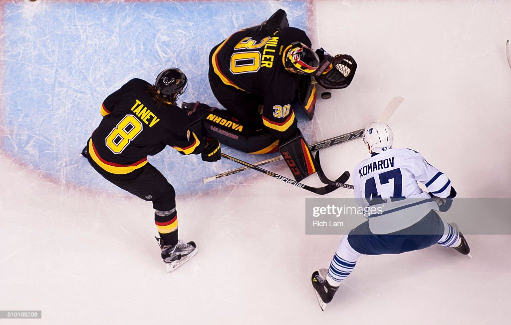Goalie Ryan Miller of the Vancouver Canucks stops Leo Komarov of the Toronto Maple Leafs in NHL action on February 2016 at Rogers Arena in Vancouver...