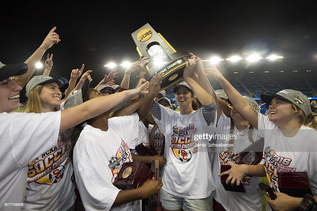 Goalie Sammy Jo Prudhomme (1) of the University of Southern California holds the trophy after defeating West Virginia University during the Division I Women's Soccer Championship held at Avaya Stadium on December 04, 2016 in San Jose, California. USC defeated West Virginia 3-1 for the national title.