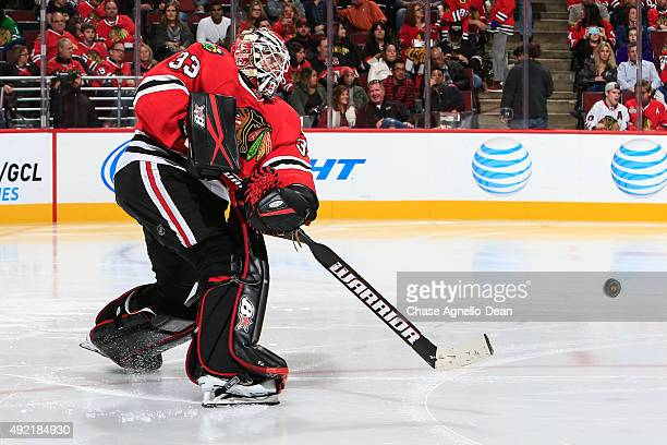 Goalie Scott Darling of the Chicago Blackhawks clears the puck in the third period of the NHL game against the New York Islanders at the United...