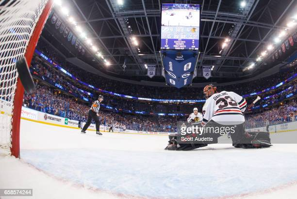 Goalie Scott Darling of the Chicago Blackhawks gives up the game winning goal to the Tampa Bay Lightning during overtime period at Amalie Arena on...