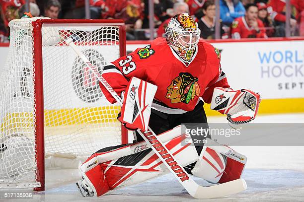 Goalie Scott Darling of the Chicago Blackhawks guards the net during the first period of the NHL game against the Minnesota Wild at the United Center...