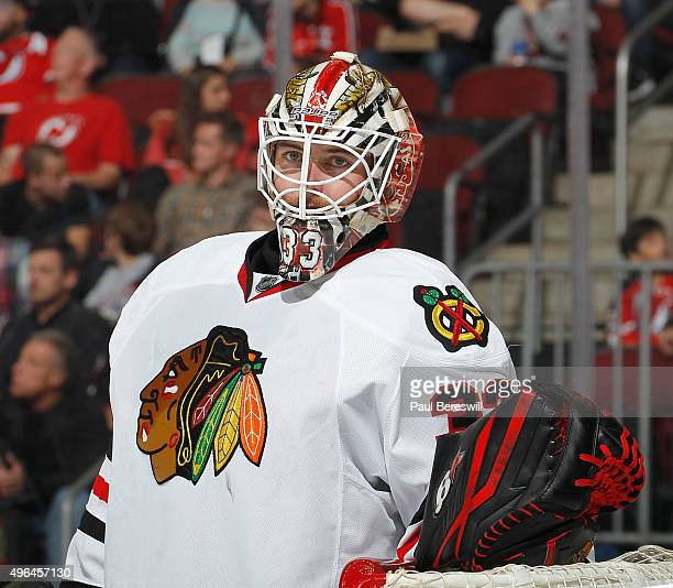 Goalie Scott Darling of the Chicago Blackhawks looks over in an NHL hockey game against the New Jersey Devils at Prudential Center on November 6 2015...