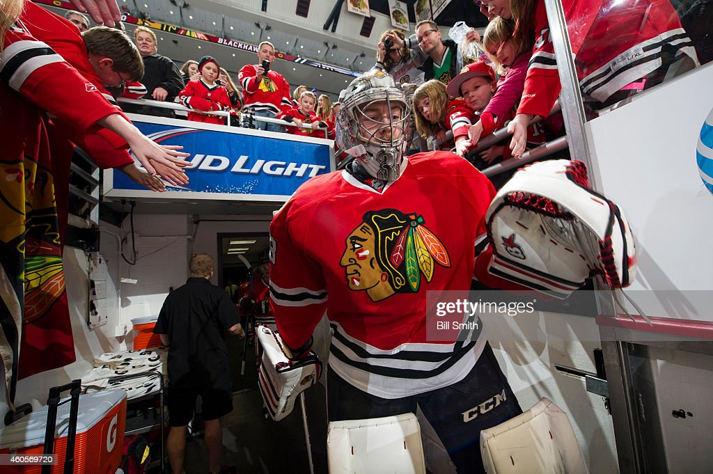 Goalie Scott Darling #33 of the Chicago Blackhawks walks out to the ice prior to the NHL game against the Minnesota Wild at the United Center on December 16, 2014 in Chicago, Illinois.