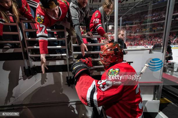 Goalie Scott Darling of the Chicago Blackhawks walks to the locker room prior to Game One of the Western Conference First Round against the Nashville...