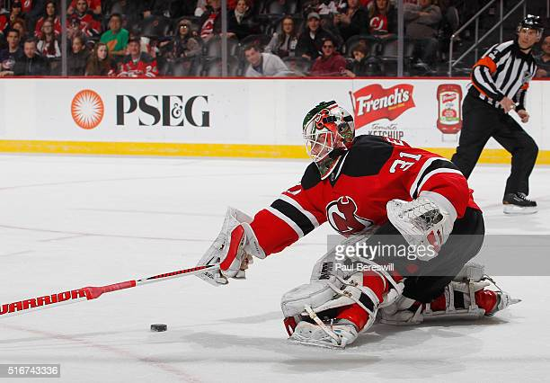 Goalie Scott Wedgewood of the New Jersey Devils stops a breakaway shot late in the third period to preserve the win in his first NHL hockey game at...