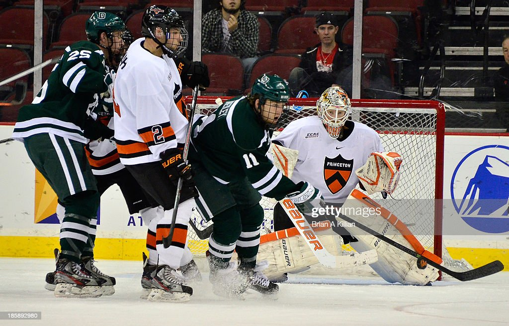 Goalie Sean Bonar #1 of the Princeton Tigers makes a save against right wing Eric Neiley #11 of the Dartmouth Big Green at Prudential Center on October 25, 2013 in Newark, New Jersey. The Princeton Tigers won 3-2 in overtime.