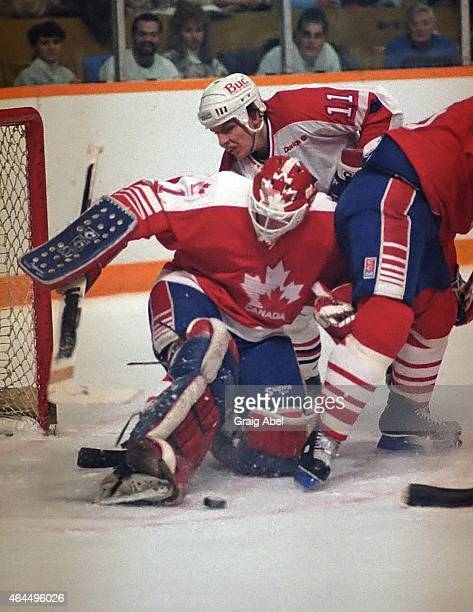 Goalie Sean Burke of Team Canada battles with Todd Okerlund of Team USA during a warmup game for the 1988 Olympics on January 18 1988 at Maple Leaf...