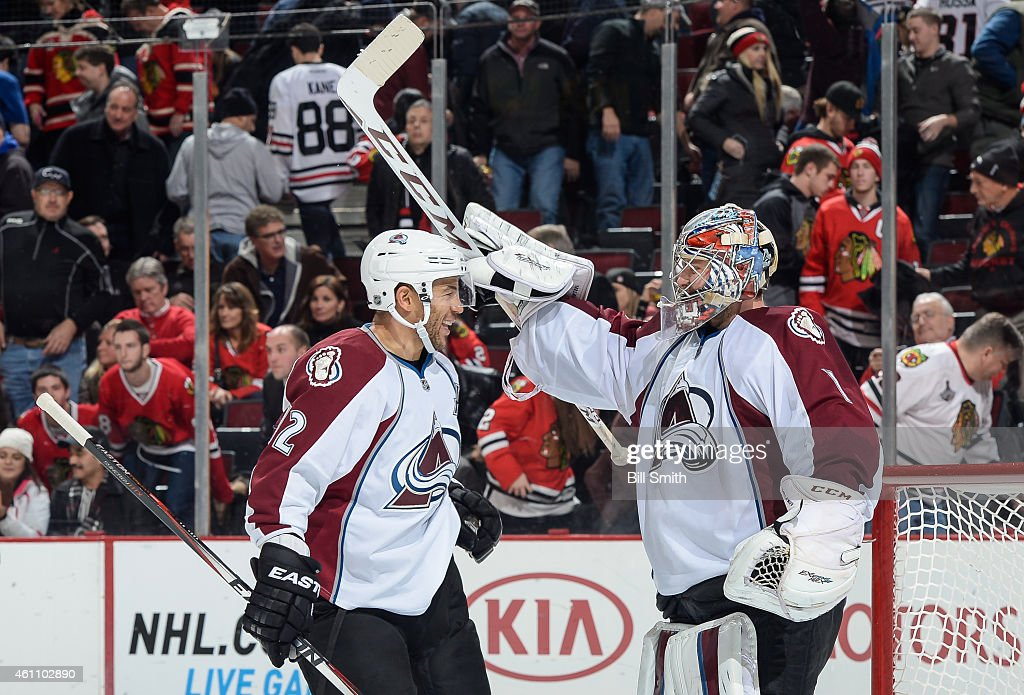 Goalie <a gi-track='captionPersonalityLinkClicked' href=/galleries/search?phrase=Semyon+Varlamov&family=editorial&specificpeople=6264893 ng-click='$event.stopPropagation()'>Semyon Varlamov</a> #1 and <a gi-track='captionPersonalityLinkClicked' href=/galleries/search?phrase=Jarome+Iginla&family=editorial&specificpeople=201792 ng-click='$event.stopPropagation()'>Jarome Iginla</a> #12 of the Colorado Avalanche celebrate after Varlamov shut out the Chicago Blackhawks 2-0 during the NHL game at the United Center on January 6, 2015 in Chicago, Illinois.