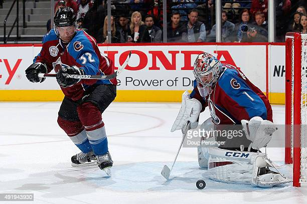 Goalie Semyon Varlamov of the Colorado Avalanche collects the puck as he defends the goal against the Minnesota Wild as Francois Beauchemin of the...