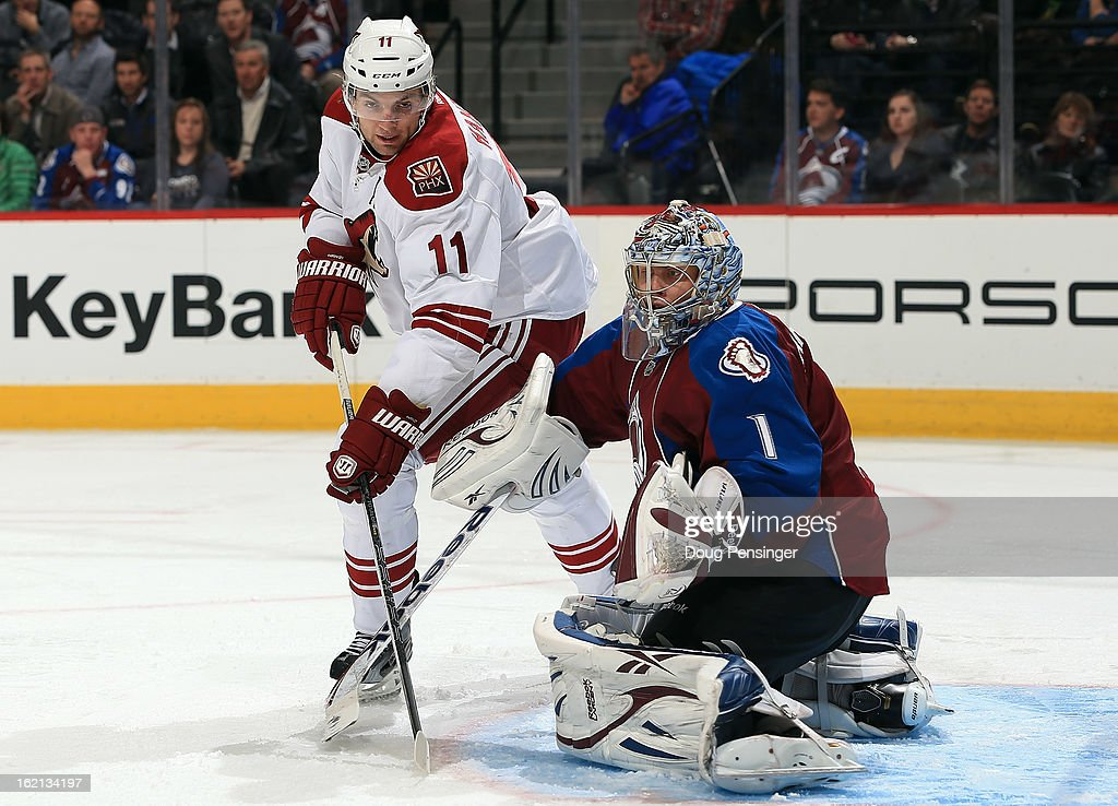 Goalie <a gi-track='captionPersonalityLinkClicked' href=/galleries/search?phrase=Semyon+Varlamov&family=editorial&specificpeople=6264893 ng-click='$event.stopPropagation()'>Semyon Varlamov</a> #1 of the Colorado Avalanche defends the goal against <a gi-track='captionPersonalityLinkClicked' href=/galleries/search?phrase=Martin+Hanzal&family=editorial&specificpeople=2109469 ng-click='$event.stopPropagation()'>Martin Hanzal</a> #11 of the Phoenix Coyotes at the Pepsi Center on February 11, 2013 in Denver, Colorado. The Coyotes defeated the Avalanche 3-2 in overtime.