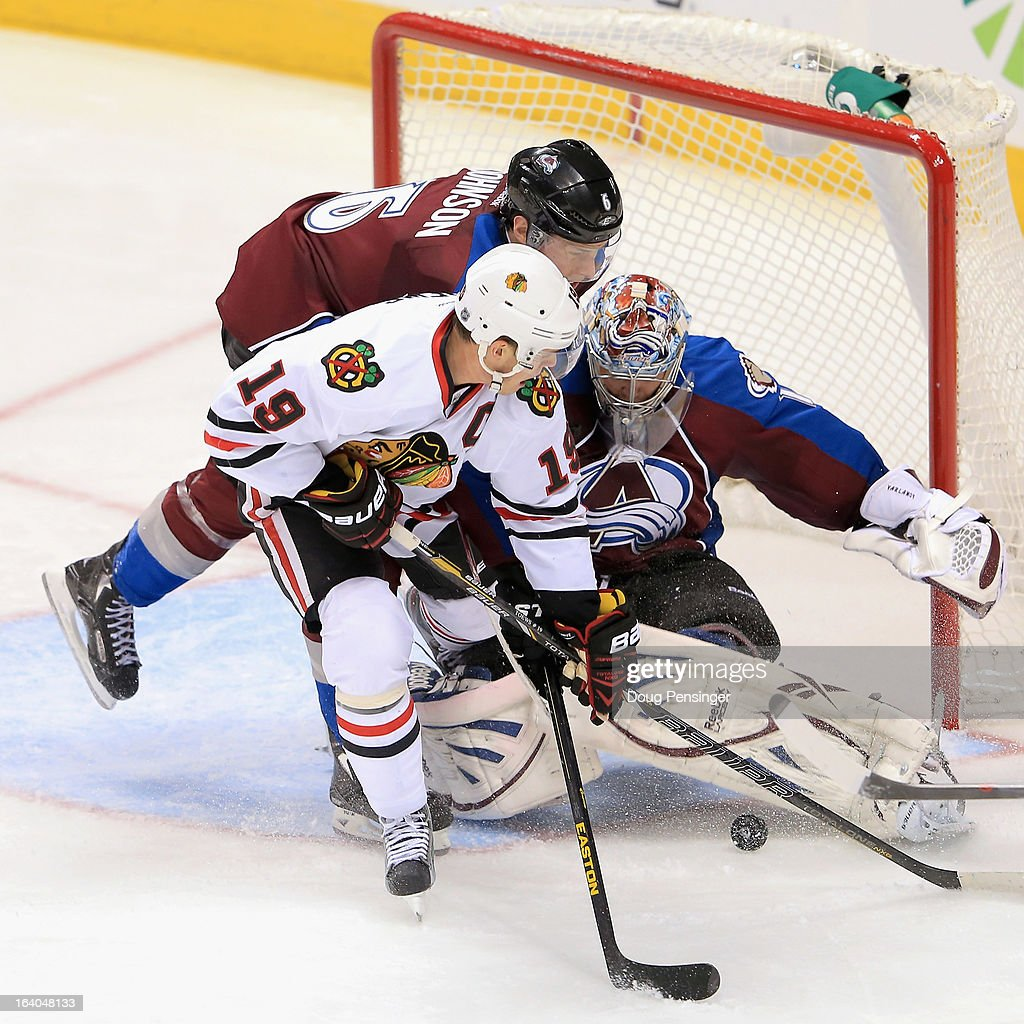 Goalie <a gi-track='captionPersonalityLinkClicked' href=/galleries/search?phrase=Semyon+Varlamov&family=editorial&specificpeople=6264893 ng-click='$event.stopPropagation()'>Semyon Varlamov</a> #1 of the Colorado Avalanche defends the goal with the help of <a gi-track='captionPersonalityLinkClicked' href=/galleries/search?phrase=Erik+Johnson+-+Ice+Hockey+Player&family=editorial&specificpeople=457696 ng-click='$event.stopPropagation()'>Erik Johnson</a> #6 of the Colorado Avalanche against the <a gi-track='captionPersonalityLinkClicked' href=/galleries/search?phrase=Jonathan+Toews&family=editorial&specificpeople=537799 ng-click='$event.stopPropagation()'>Jonathan Toews</a> #19 of the Chicago Blackhawks at the Pepsi Center on March 18, 2013 in Denver, Colorado. The Blackhawks defeated the Avalanche 5-2.