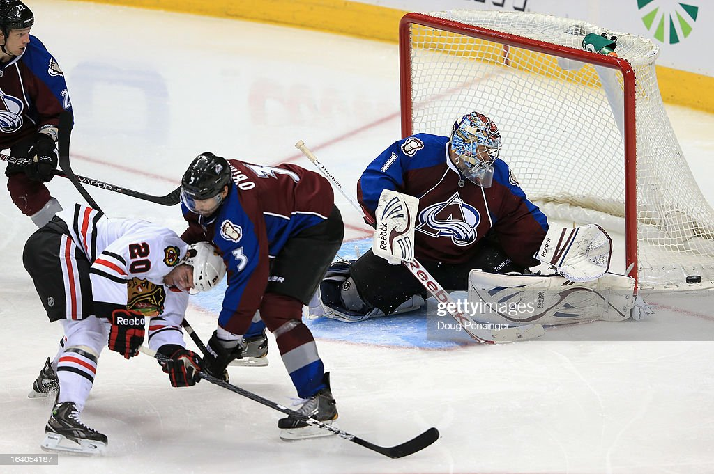 Goalie Semyon Varlamov #1 of the Colorado Avalanche deflects the puck as Ryan O'Byrne #3 of the Colorado Avalanche defends against Brandon Saad #20 of the Chicago Blackhawks at the Pepsi Center on March 18, 2013 in Denver, Colorado. The Blackhawks defeated the Avalanche 5-2.