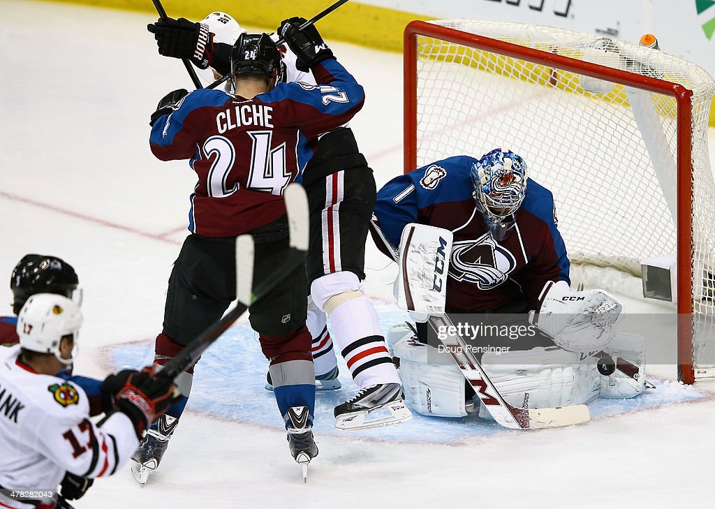 Goalie Semyon Varlamov #1 of the Colorado Avalanche deflects the puck as he makes a save against the Chicago Blackhawks at Pepsi Center on March 12, 2014 in Denver, Colorado. The Avalanche defeated the Blackhawks 3-2.