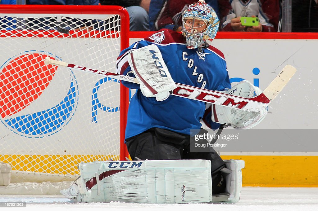 Goalie <a gi-track='captionPersonalityLinkClicked' href=/galleries/search?phrase=Semyon+Varlamov&family=editorial&specificpeople=6264893 ng-click='$event.stopPropagation()'>Semyon Varlamov</a> #1 of the Colorado Avalanche deflects the puck against the Washington Capitals at Pepsi Center on November 10, 2013 in Denver, Colorado. The Avalanche defeated the Capitals 4-1.