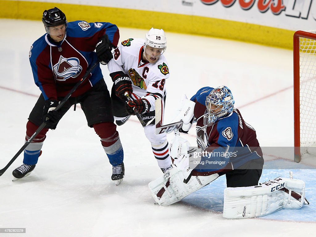 Goalie <a gi-track='captionPersonalityLinkClicked' href=/galleries/search?phrase=Semyon+Varlamov&family=editorial&specificpeople=6264893 ng-click='$event.stopPropagation()'>Semyon Varlamov</a> #1 of the Colorado Avalanche makes a glove save as <a gi-track='captionPersonalityLinkClicked' href=/galleries/search?phrase=Erik+Johnson+-+Ice+Hockey+Player&family=editorial&specificpeople=457696 ng-click='$event.stopPropagation()'>Erik Johnson</a> #6 of the Colorado Avalanche defends against <a gi-track='captionPersonalityLinkClicked' href=/galleries/search?phrase=Jonathan+Toews&family=editorial&specificpeople=537799 ng-click='$event.stopPropagation()'>Jonathan Toews</a> #19 of the Chicago Blackhawks at Pepsi Center on March 12, 2014 in Denver, Colorado. The Avalanche defeated the Blackhawks 3-2.