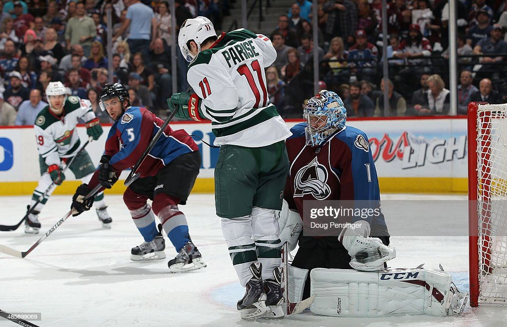 Goalie <a gi-track='captionPersonalityLinkClicked' href=/galleries/search?phrase=Semyon+Varlamov&family=editorial&specificpeople=6264893 ng-click='$event.stopPropagation()'>Semyon Varlamov</a> #1 of the Colorado Avalanche makes a glove save behind <a gi-track='captionPersonalityLinkClicked' href=/galleries/search?phrase=Zach+Parise&family=editorial&specificpeople=213606 ng-click='$event.stopPropagation()'>Zach Parise</a> #11 of the Minnesota Wild in Game Two of the First Round of the 2014 NHL Stanley Cup Playoffs at Pepsi Center on April 19, 2014 in Denver, Colorado. The Avalanche defeated the Wild 4-2 to take a 2-0 game lead in the series.