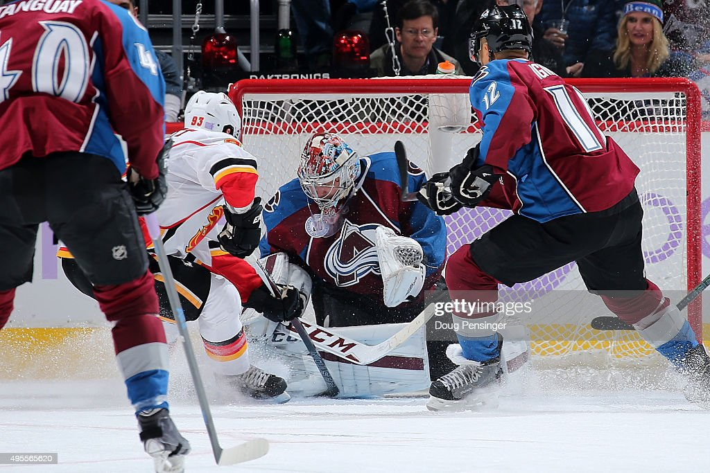 Goalie Semyon Varlamov #1 of the Colorado Avalanche makes a save against Sam Bennett #93 of the Calgary Flames at Pepsi Center on November 3, 2015 in Denver, Colorado. The Avalanche defeated the Flames 6-3.