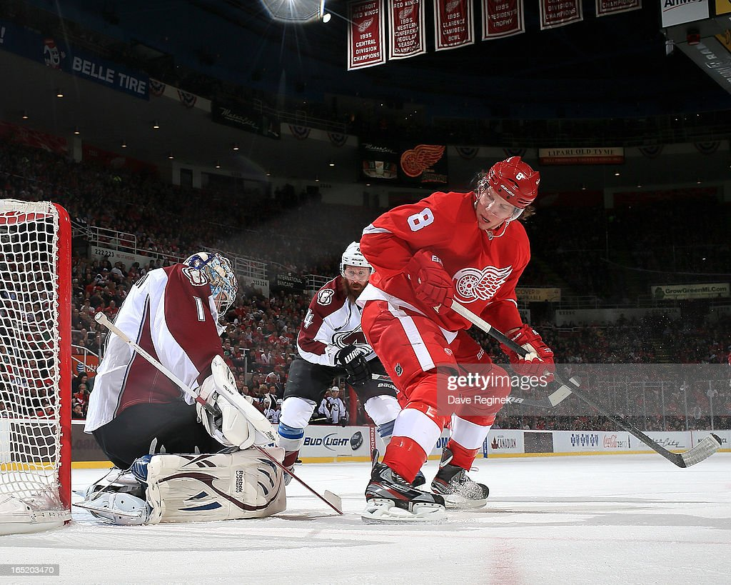 Goalie Semyon Varlamov #1 of the Colorado Avalanche makes a save as teamate Greg Zanon #4 rushes to defend Justin Abdelkader #8 of the Detroit Red Wings in front of the net during a NHL game at Joe Louis Arena on April 1, 2013 in Detroit, Michigan.