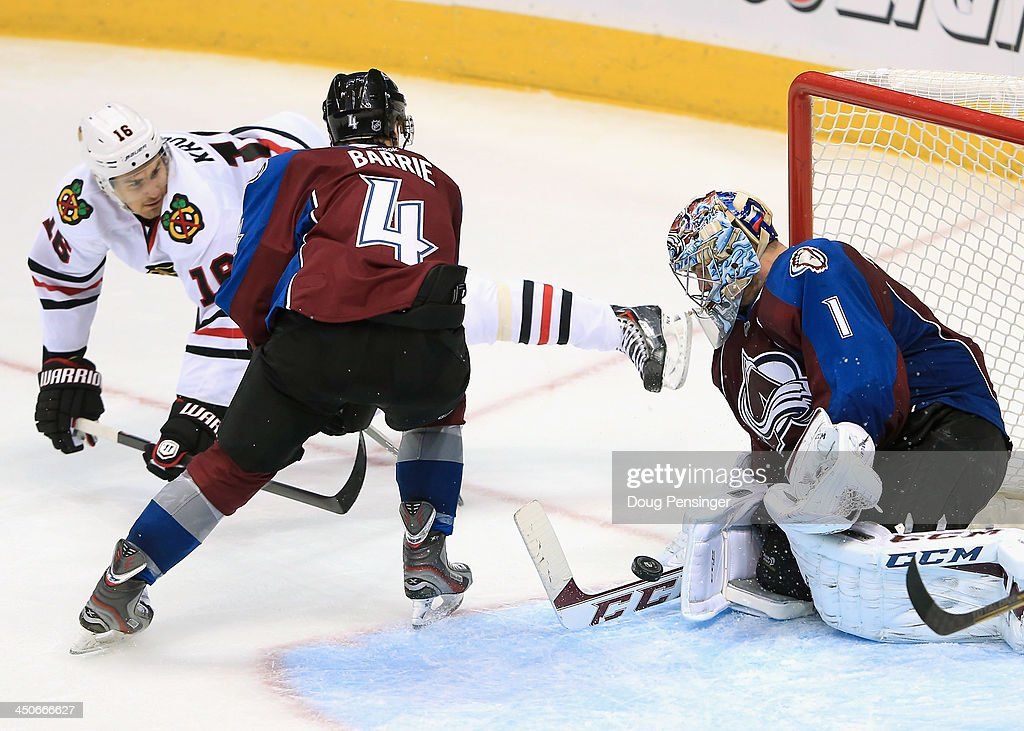 Goalie <a gi-track='captionPersonalityLinkClicked' href=/galleries/search?phrase=Semyon+Varlamov&family=editorial&specificpeople=6264893 ng-click='$event.stopPropagation()'>Semyon Varlamov</a> #1 of the Colorado Avalanche makes a save on a shot by Marcus Kruger #16 of the Chicago Blackhawks as <a gi-track='captionPersonalityLinkClicked' href=/galleries/search?phrase=Tyson+Barrie&family=editorial&specificpeople=4669265 ng-click='$event.stopPropagation()'>Tyson Barrie</a> #4 of the Colorado Avalanche defends at Pepsi Center on November 19, 2013 in Denver, Colorado. The Avalacnhe defeated the Blackhawks 5-1.