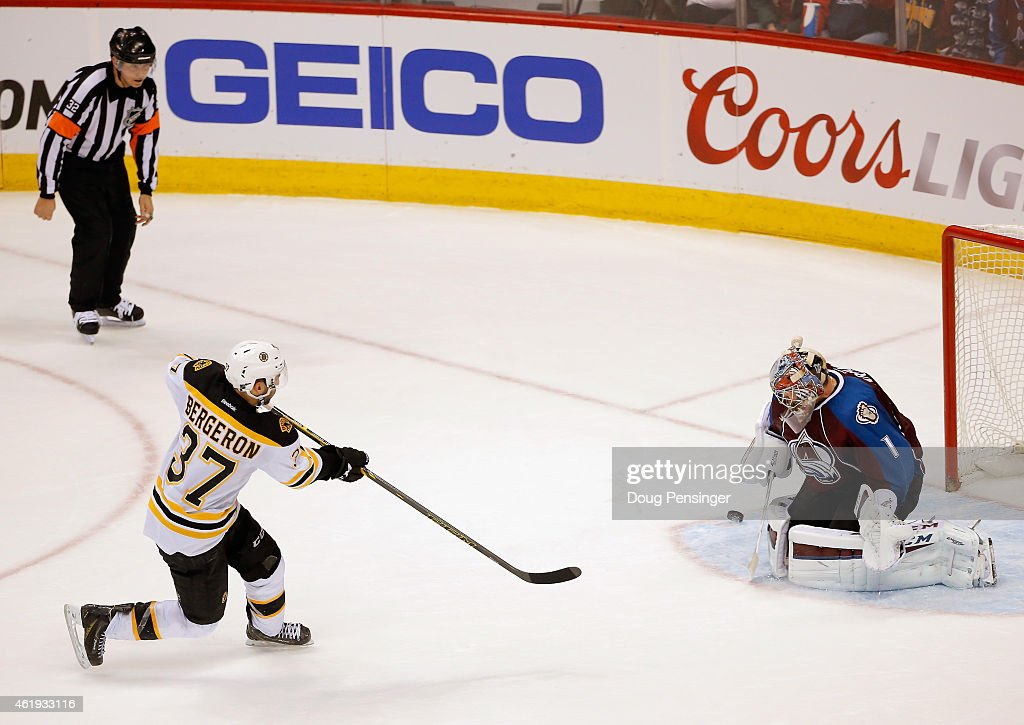 Goalie Semyon Varlamov #1 of the Colorado Avalanche makes a save on a penalty shot by Patrice Bergeron #37 of the Boston Bruins on the final shot of the shootout to win the game at Pepsi Center on January 21, 2015 in Denver, Colorado. The Avalanche defeated the Bruins 3-2 in an overtime shootout.