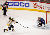 Goalie Semyon Varlamov of the Colorado Avalanche makes a save on a penalty shot by Patrice Bergeron of the Boston Bruins on the final shot of the...