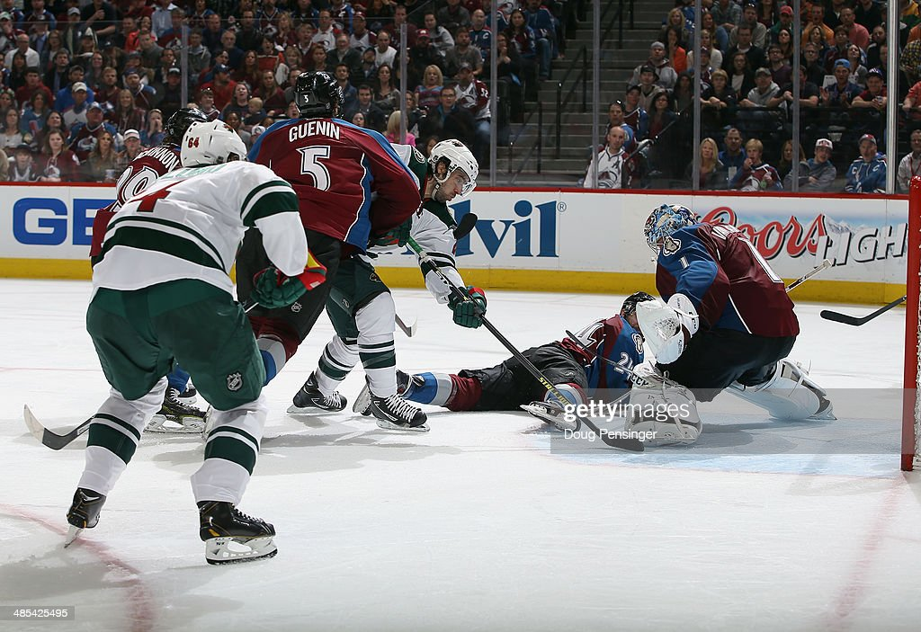 Goalie <a gi-track='captionPersonalityLinkClicked' href=/galleries/search?phrase=Semyon+Varlamov&family=editorial&specificpeople=6264893 ng-click='$event.stopPropagation()'>Semyon Varlamov</a> #1 of the Colorado Avalanche makes a save on a shot by <a gi-track='captionPersonalityLinkClicked' href=/galleries/search?phrase=Matt+Moulson&family=editorial&specificpeople=3365493 ng-click='$event.stopPropagation()'>Matt Moulson</a> #26 of the Minnesota Wild in Game One of the First Round of the 2014 NHL Stanley Cup Playoffs at Pepsi Center on April 17, 2014 in Denver, Colorado. The Avalanche defeated the Wild 5-4 in overtime to take a 1-0 game advantage in the series.