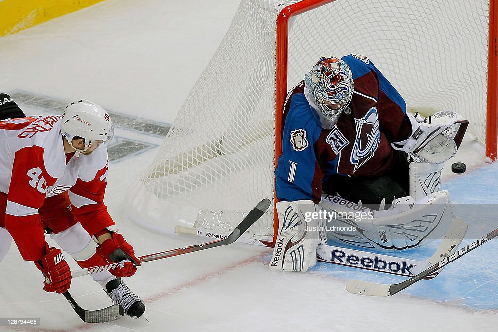 Goalie <a gi-track='captionPersonalityLinkClicked' href=/galleries/search?phrase=Semyon+Varlamov&family=editorial&specificpeople=6264893 ng-click='$event.stopPropagation()'>Semyon Varlamov</a> #1 of the Colorado Avalanche makes a save on <a gi-track='captionPersonalityLinkClicked' href=/galleries/search?phrase=Henrik+Zetterberg&family=editorial&specificpeople=201520 ng-click='$event.stopPropagation()'>Henrik Zetterberg</a> #40 of the Detroit Red Wings during the second period at Pepsi Center on October 8, 2011 in Denver, Colorado.