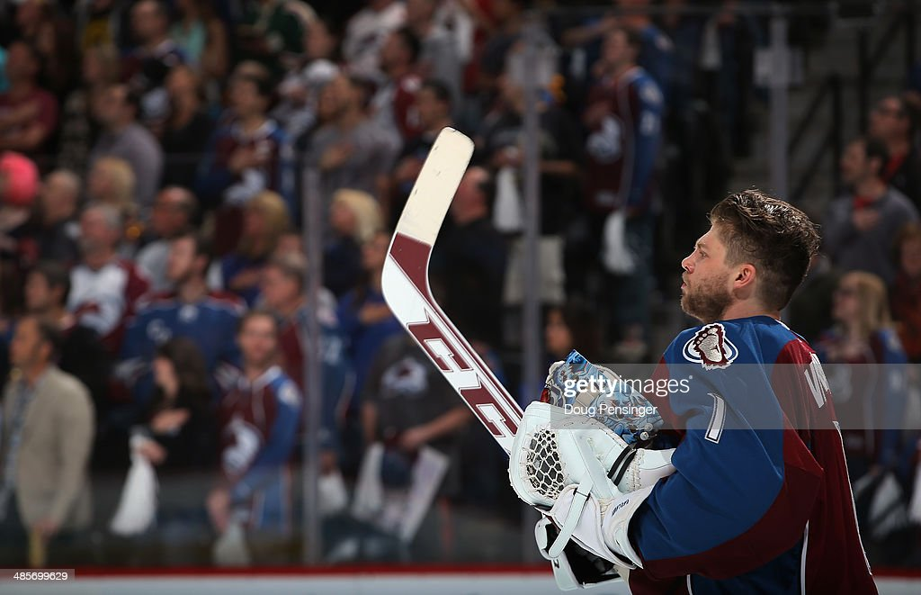 Goalie <a gi-track='captionPersonalityLinkClicked' href=/galleries/search?phrase=Semyon+Varlamov&family=editorial&specificpeople=6264893 ng-click='$event.stopPropagation()'>Semyon Varlamov</a> #1 of the Colorado Avalanche observes the national anthem prior to facing the Minnesota Wild in Game Two of the First Round of the 2014 NHL Stanley Cup Playoffs at Pepsi Center on April 19, 2014 in Denver, Colorado. The Avalanche defeated the Wild 4-2 to take a 2-0 game lead in the series.