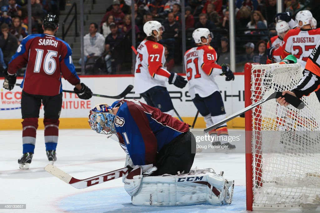 Goalie <a gi-track='captionPersonalityLinkClicked' href=/galleries/search?phrase=Semyon+Varlamov&family=editorial&specificpeople=6264893 ng-click='$event.stopPropagation()'>Semyon Varlamov</a> #1 of the Colorado Avalanche reacts as the Florida Panthers celebrate a goal by Jonathan Huberdeau #11 of the Florida Panthers in the third period at Pepsi Center on November 16, 2013 in Denver, Colorado. The Panthers defeated the Avalanche 4-1.