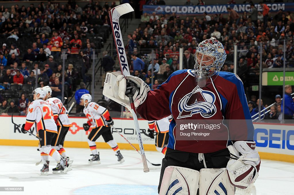 Goalie Semyon Varlamov #1 of the Colorado Avalanche skates away from the goal as <a gi-track='captionPersonalityLinkClicked' href=/galleries/search?phrase=Jarome+Iginla&family=editorial&specificpeople=201792 ng-click='$event.stopPropagation()'>Jarome Iginla</a> #12 of the Calgary Flames celebrates his goal with his teammates to give the Flames a 3-0 lead in the first period at the Pepsi Center on February 28, 2013 in Denver, Colorado.