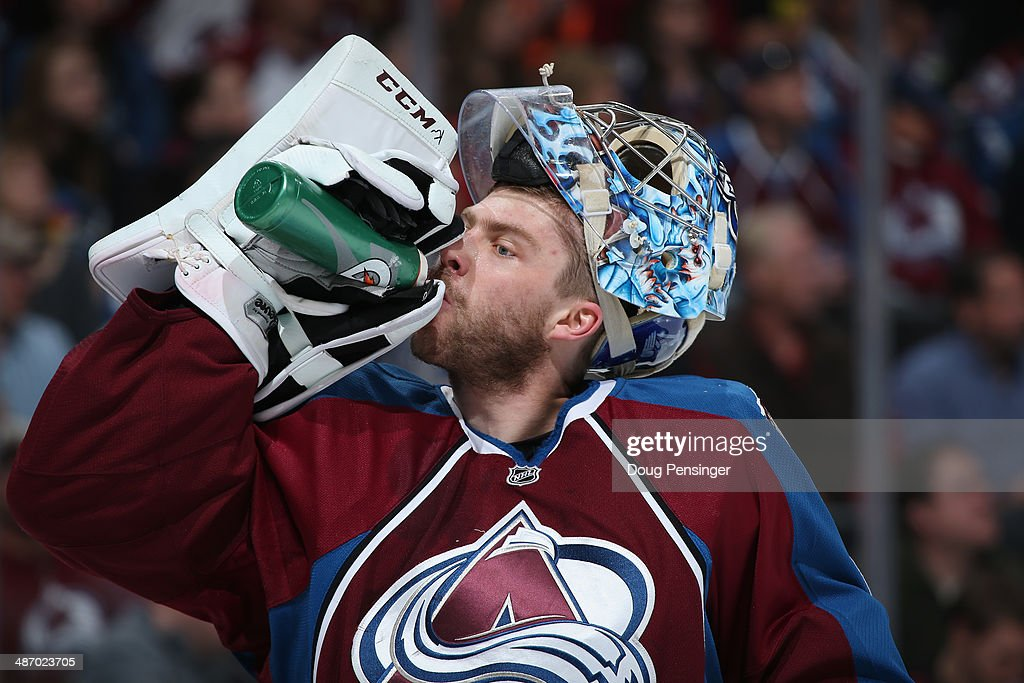 Goalie Semyon Varlamov #1 of the Colorado Avalanche takes a drink during a break in the action against the Minnesota Wild Game Five of the First Round of the 2014 NHL Stanley Cup Playoffs at Pepsi Center on April 26, 2014 in Denver, Colorado. The Avalanche defeated the Wild 4-3 in overtime to take a 3-2 game lead in the series.