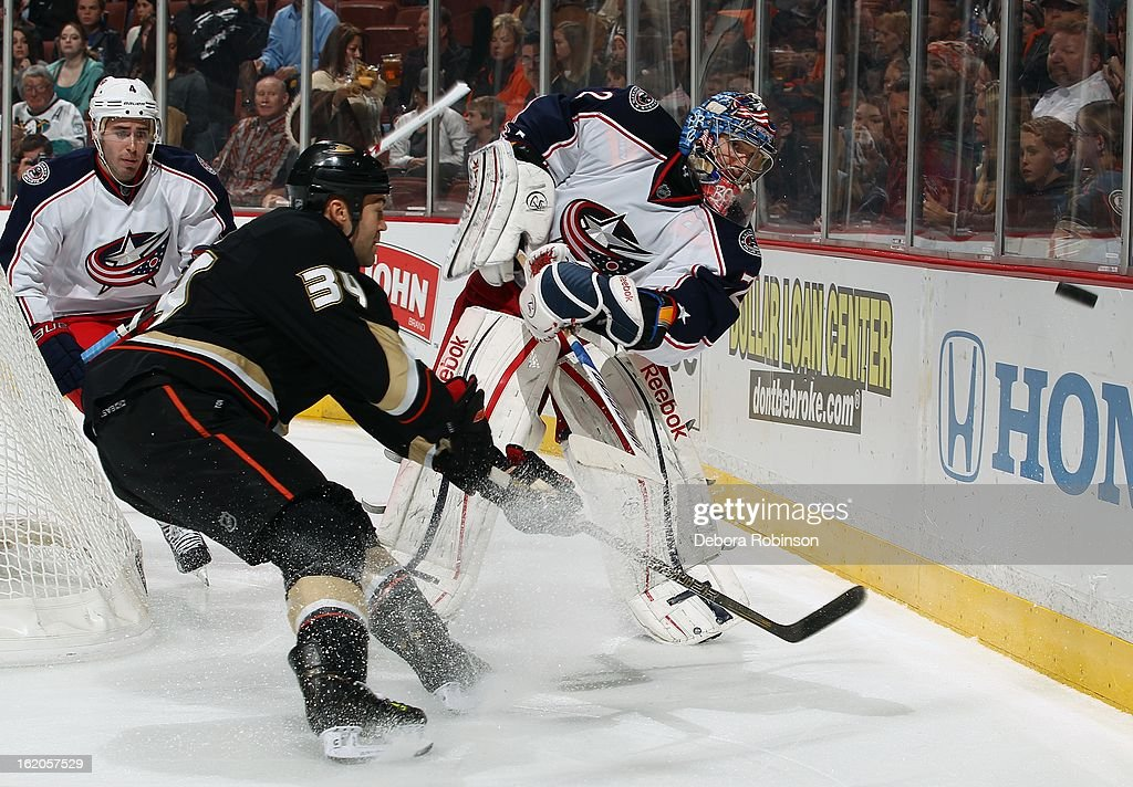 Goalie <a gi-track='captionPersonalityLinkClicked' href=/galleries/search?phrase=Sergei+Bobrovsky&family=editorial&specificpeople=4488556 ng-click='$event.stopPropagation()'>Sergei Bobrovsky</a> #72 of the Columbus Blue Jackets clears the puck from behind the net against <a gi-track='captionPersonalityLinkClicked' href=/galleries/search?phrase=Daniel+Winnik&family=editorial&specificpeople=2529214 ng-click='$event.stopPropagation()'>Daniel Winnik</a> #34 of the Anaheim Ducks on February 18, 2013 at Honda Center in Anaheim, California.