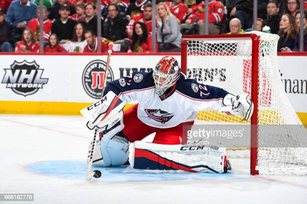 Goalie Sergei Bobrovsky of the Columbus Blue Jackets grabs the puck in the third period against the Chicago Blackhawks at the United Center on March...