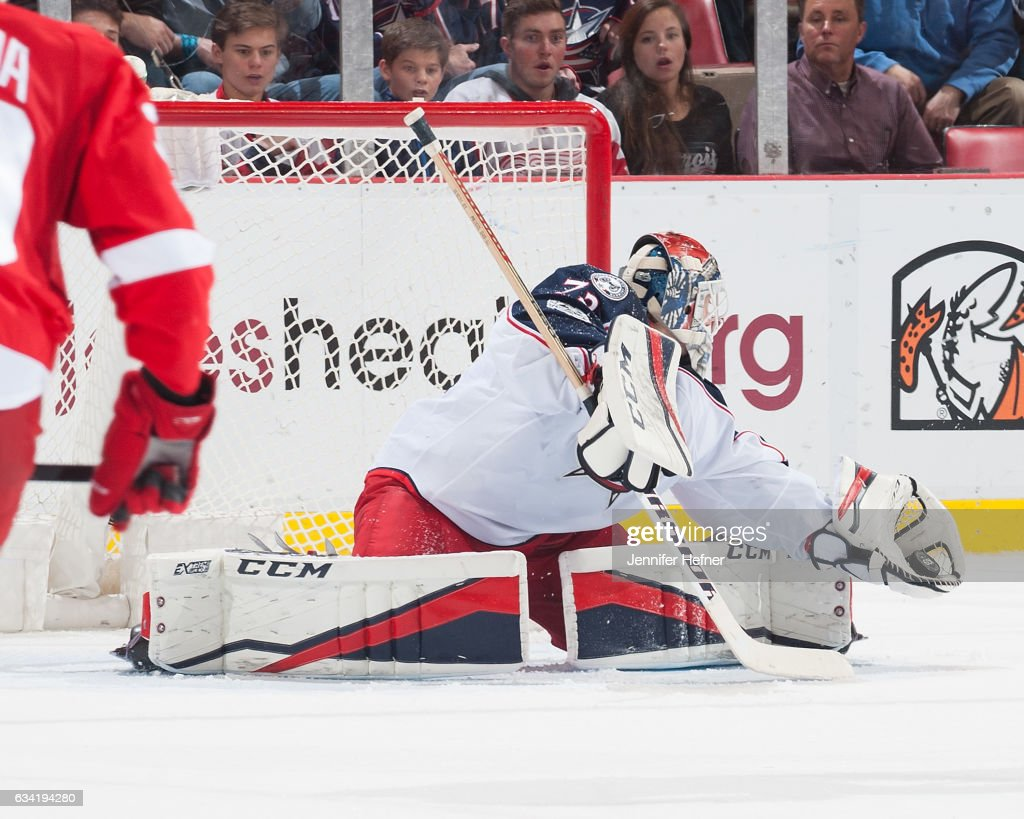 Goalie Sergei Bobrovsky #72 of the Columbus Blue Jackets makes a glove save during an NHL game against the Detroit Red Wings at Joe Louis Arena on February 7, 2017 in Detroit, Michigan. The Blue Jackets defeated the Wings 3-2 in OT.