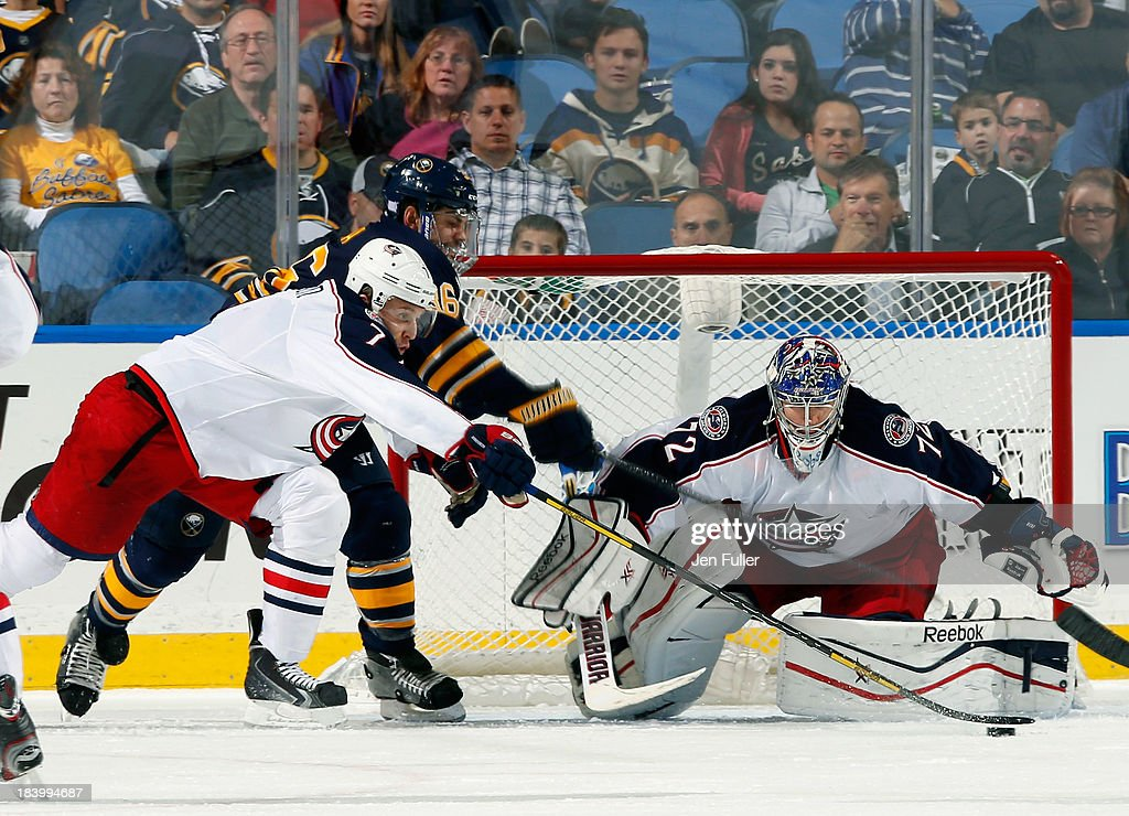 Goalie <a gi-track='captionPersonalityLinkClicked' href=/galleries/search?phrase=Sergei+Bobrovsky&family=editorial&specificpeople=4488556 ng-click='$event.stopPropagation()'>Sergei Bobrovsky</a> #72 of the Columbus Blue Jackets tends goal as teammate Jack Johnson #7 and <a gi-track='captionPersonalityLinkClicked' href=/galleries/search?phrase=Patrick+Kaleta&family=editorial&specificpeople=714513 ng-click='$event.stopPropagation()'>Patrick Kaleta</a> #36 of the Buffalo Sabres battle for the puck at First Niagara Center on October 10, 2013 in Buffalo, New York. Columbus defeated Buffalo 4-1.