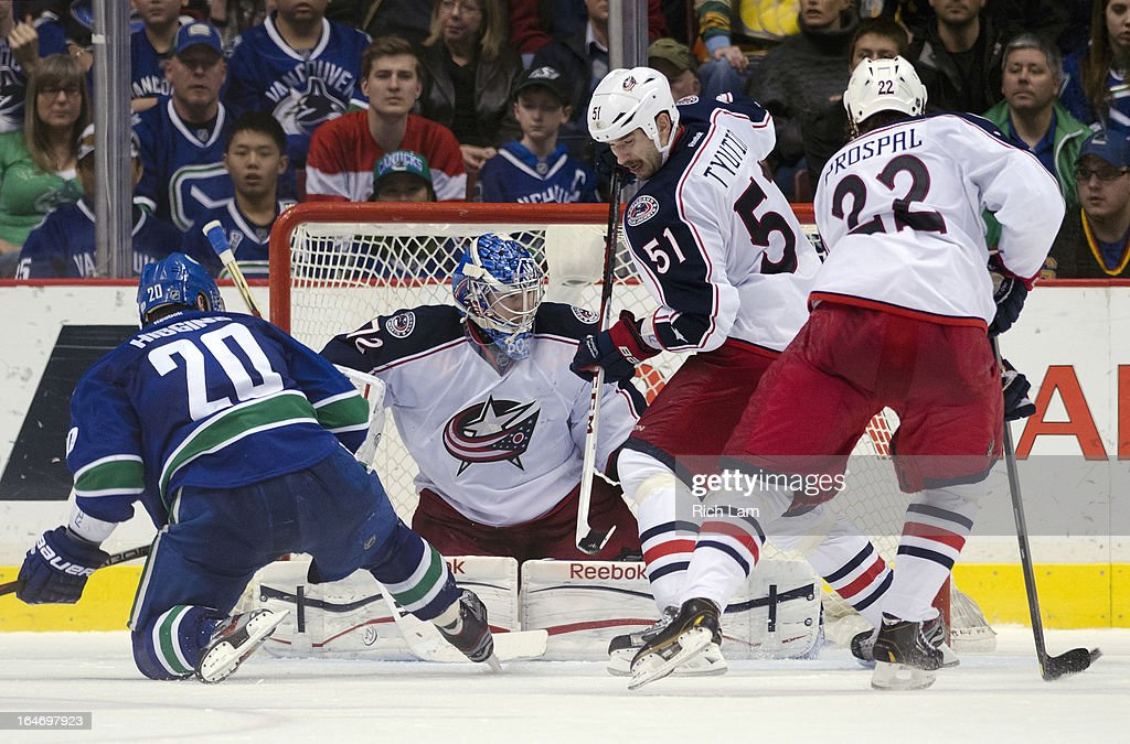Goalie <a gi-track='captionPersonalityLinkClicked' href=/galleries/search?phrase=Sergei+Bobrovsky&family=editorial&specificpeople=4488556 ng-click='$event.stopPropagation()'>Sergei Bobrovsky</a> #72 of the Columbus Blue Jackets watches the puck slide across the front of the net while Chris Higgins #20 of the Vancouver Canucks, <a gi-track='captionPersonalityLinkClicked' href=/galleries/search?phrase=Fedor+Tyutin&family=editorial&specificpeople=215245 ng-click='$event.stopPropagation()'>Fedor Tyutin</a> #51 of the Columbus Blue Jackets and Vinny Prospal #22 look on during the third period in NHL action on March 26, 2013 at Rogers Arena in Vancouver, British Columbia, Canada.