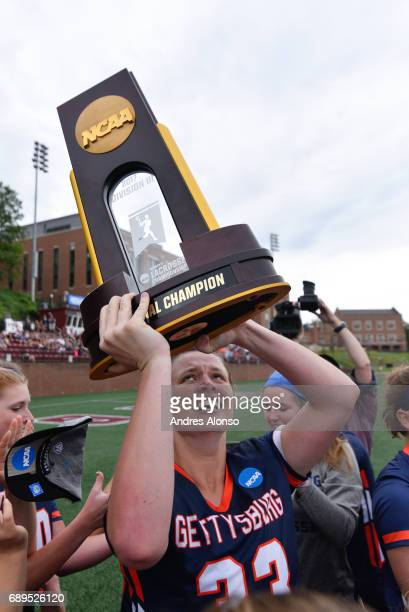 Goalie Shannon Keeler of Gettysburg College lifts the Championship trophy after the Division III Women's Lacrosse Championship held at Kerr Stadium...