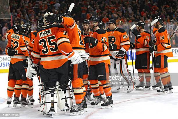 Goalie Steve Mason of the Philadelphia Flyers celebrates with teammates after defeating the Washington Capitals at Wells Fargo Center on March 30...